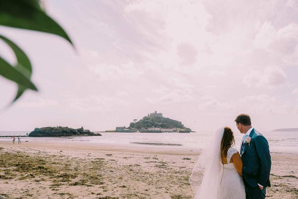 The bride and groom on Marazion beach