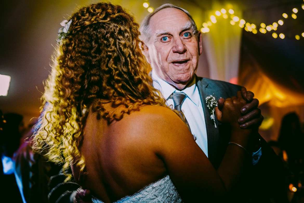 The bride dances with her granddad