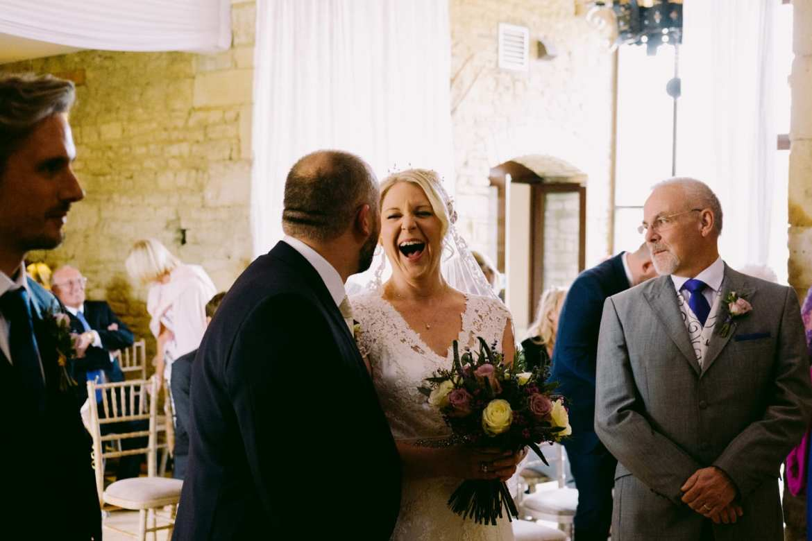 wedding ceremony with bride laughing