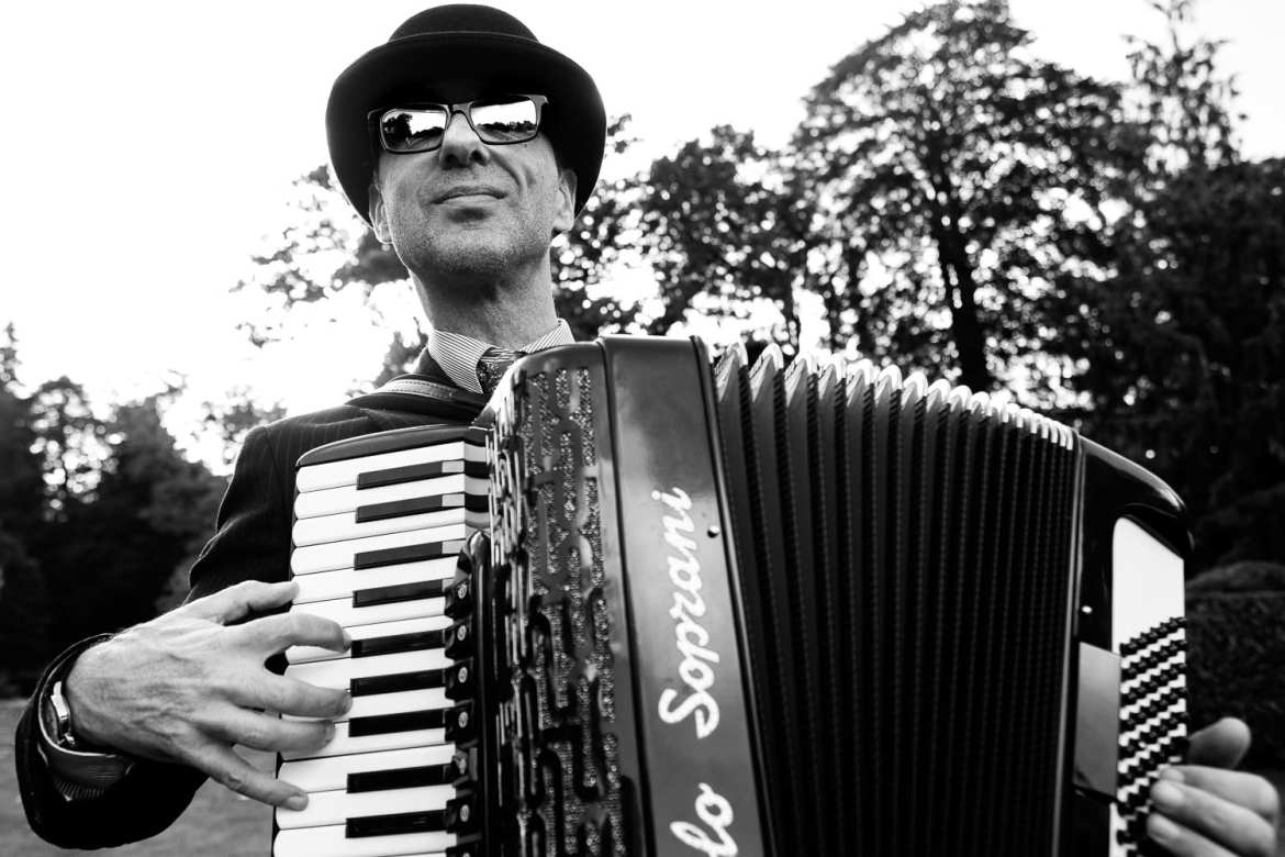 Black and white shot of accordion player
