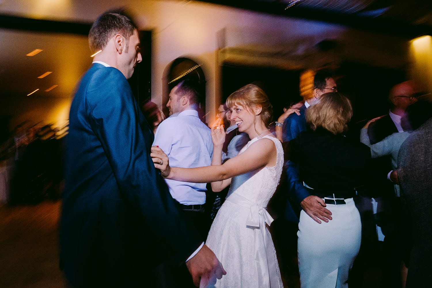 THe bride and groom dancing