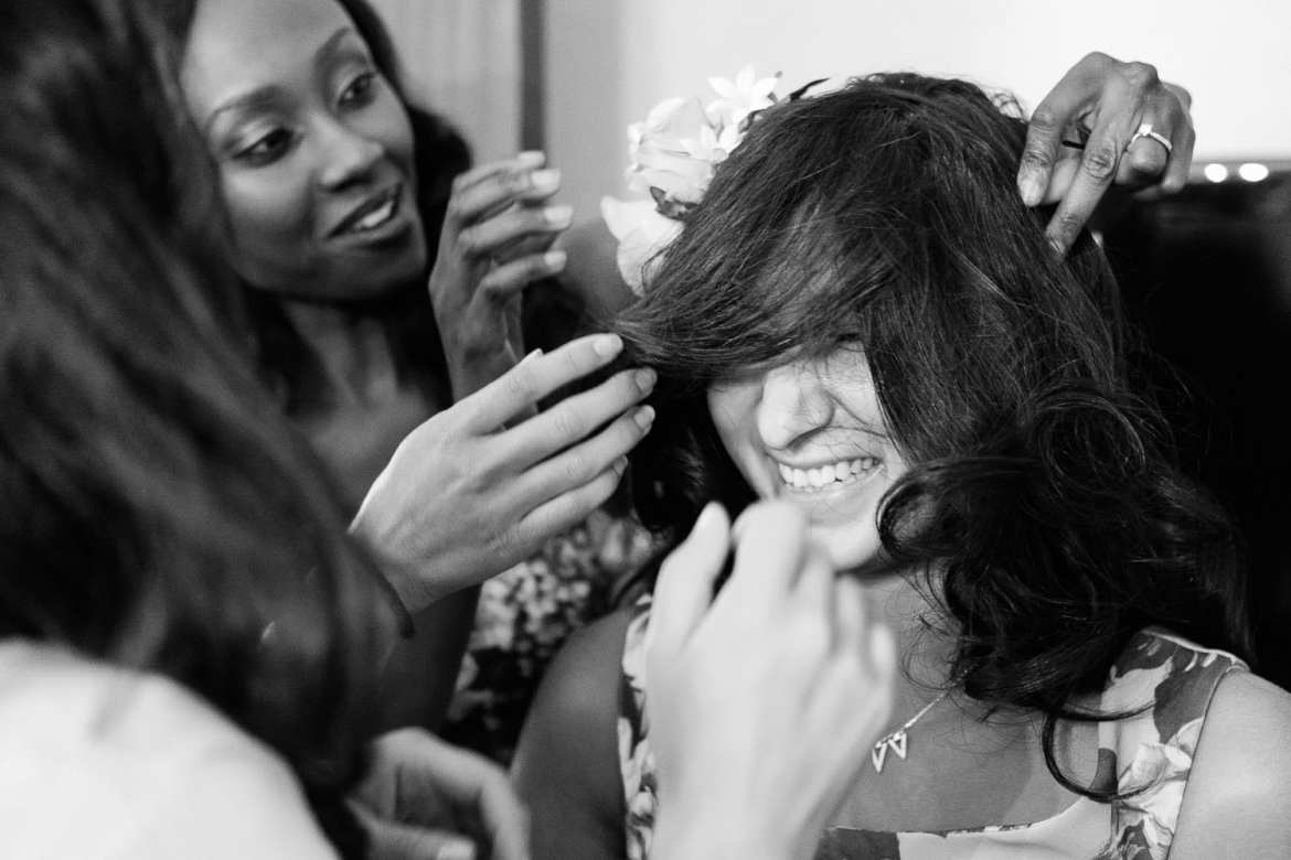 Bridesmaids laughing and doing their hair