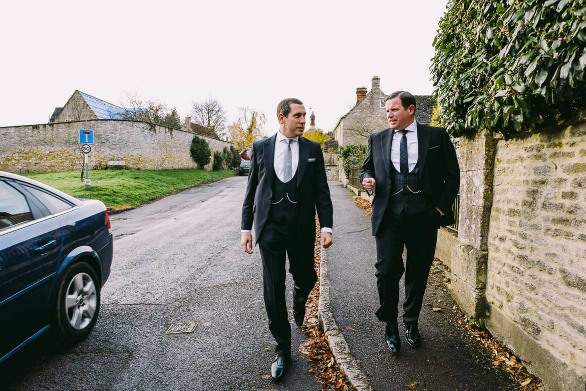 The groom and best man walking to the pub