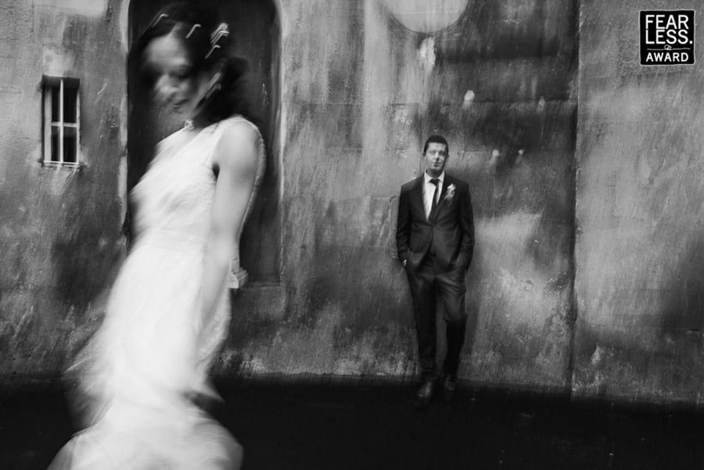 A unique slow shutter portrait of a bride and groom