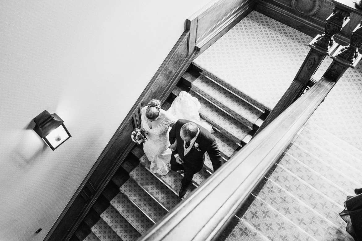 Bride and her father going down the staircase