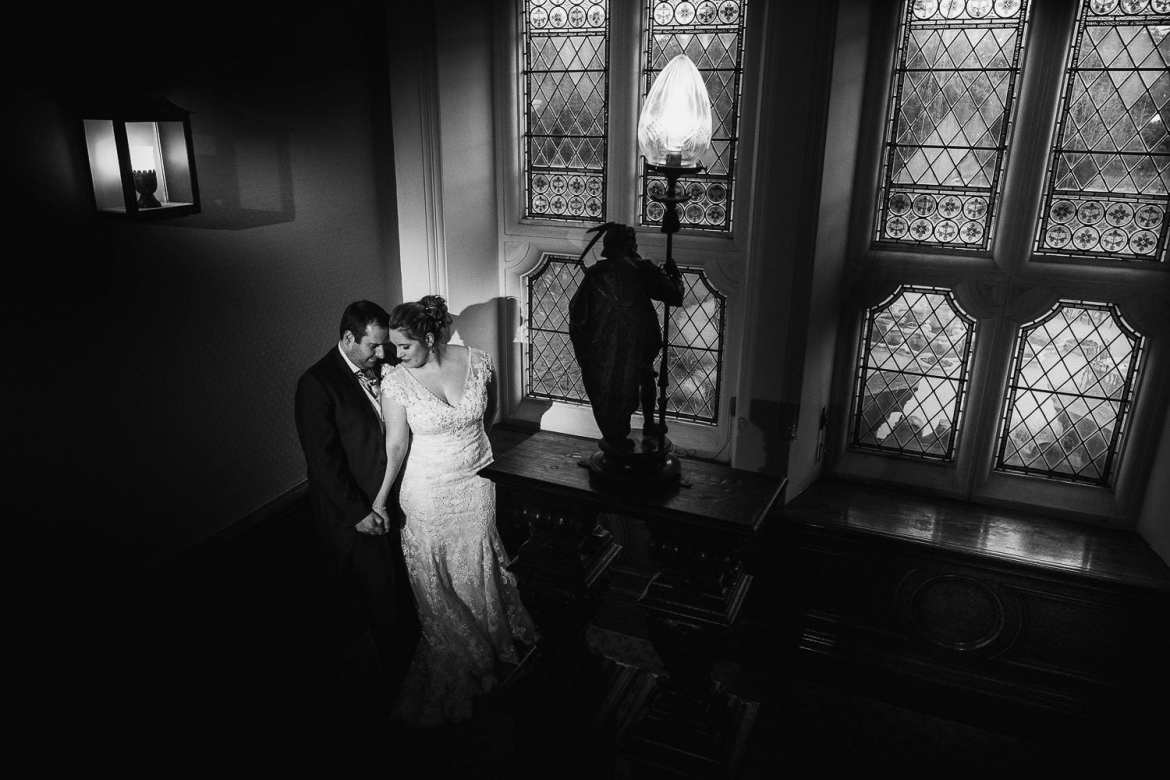 Bride and groom on the staircase