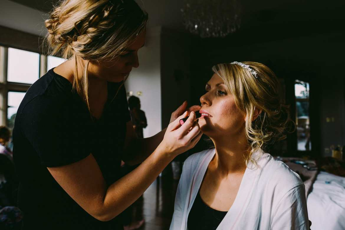 The bride having makeup applied