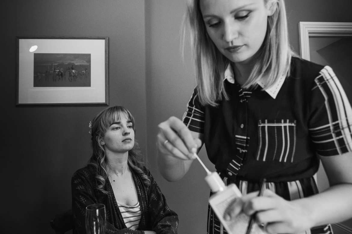 A bridesmaid having her makeup done