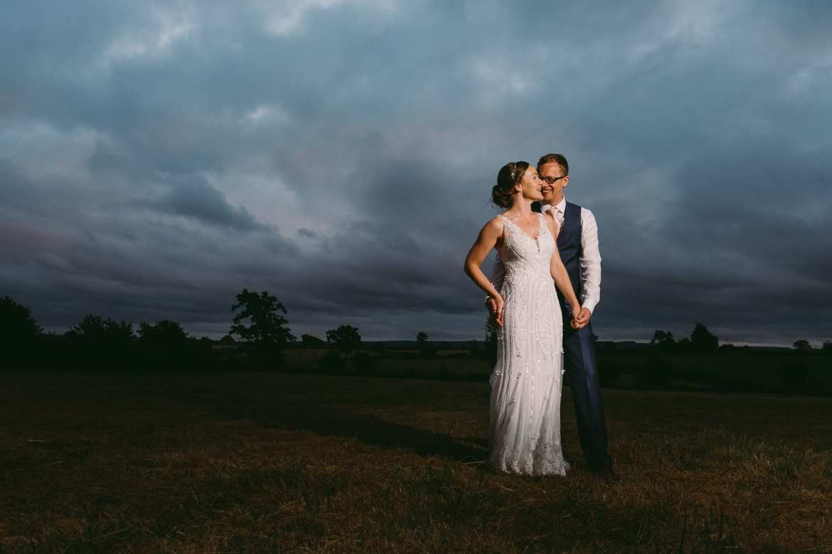 An evening portrait of the bride and groom