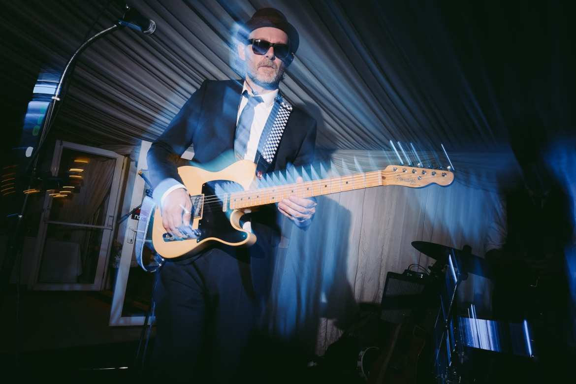 The wedding band's guitarist