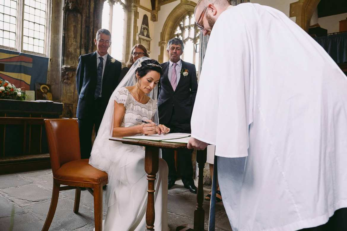 signing the register in Lacock