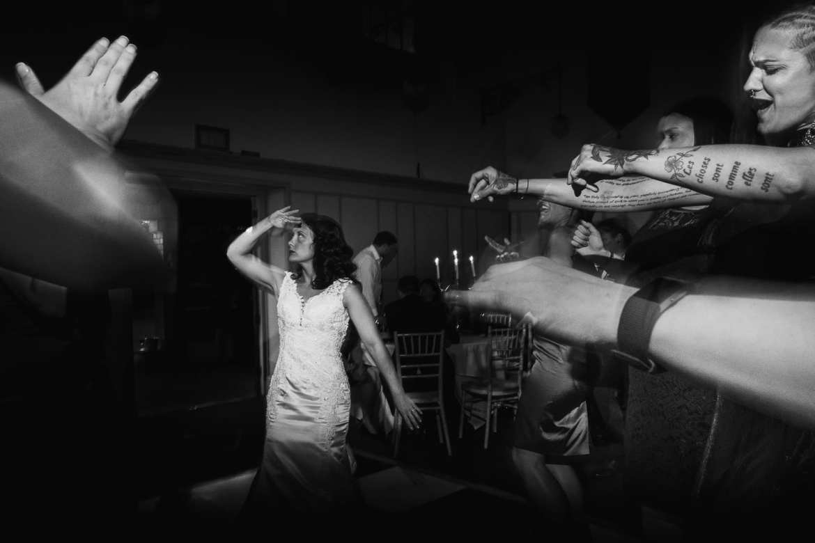 The bride and her guests dancing a routine