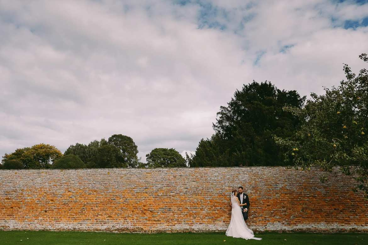 The bride and groom against a wall
