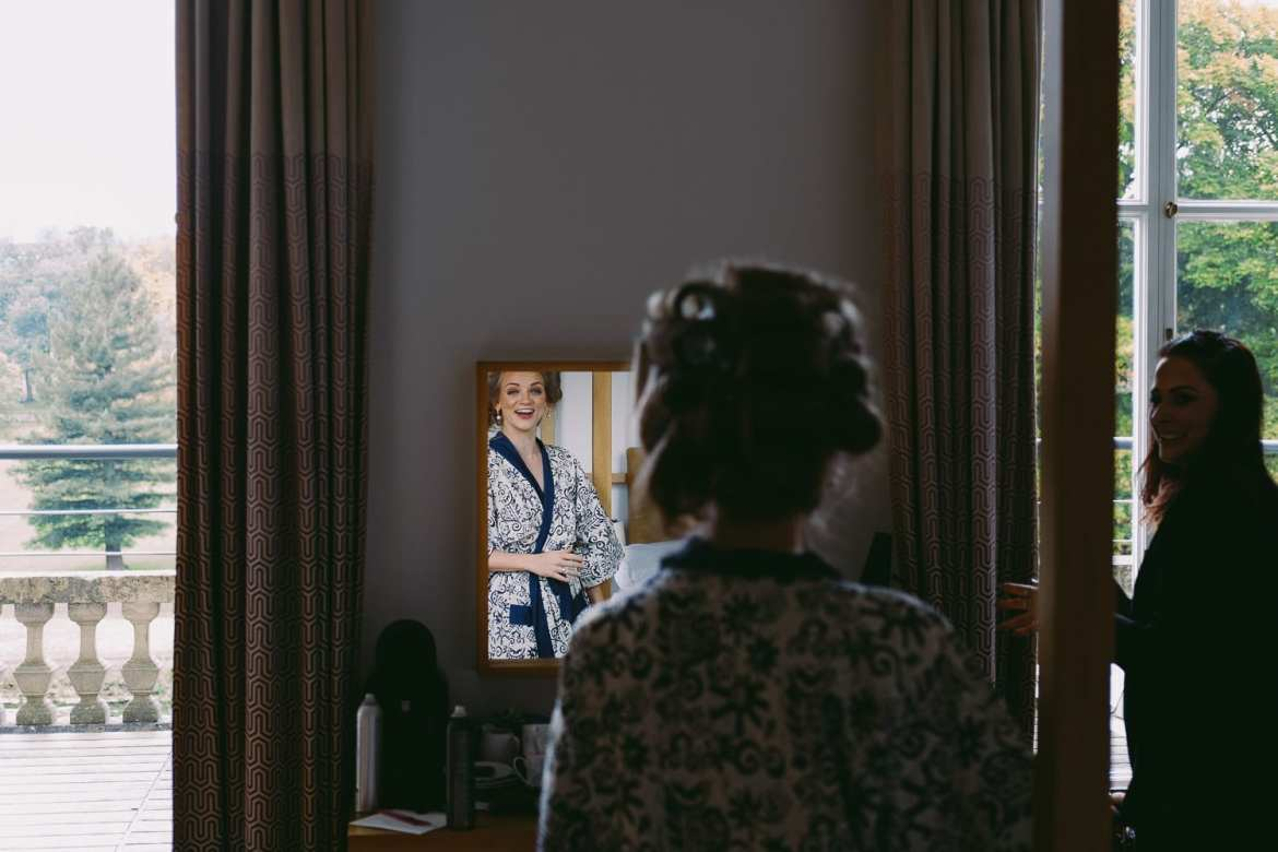Bridesmaid looking in the mirror