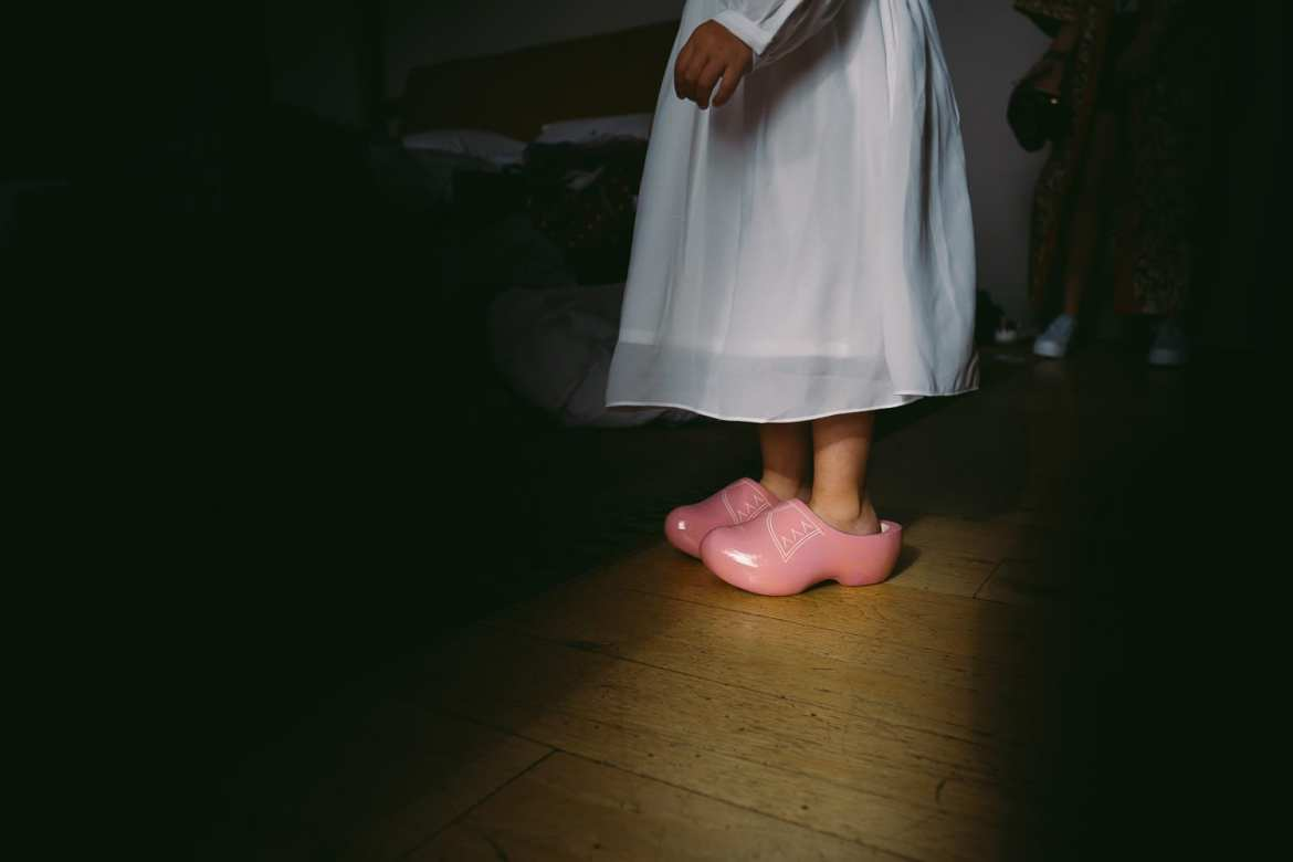Flower girl in her clogs