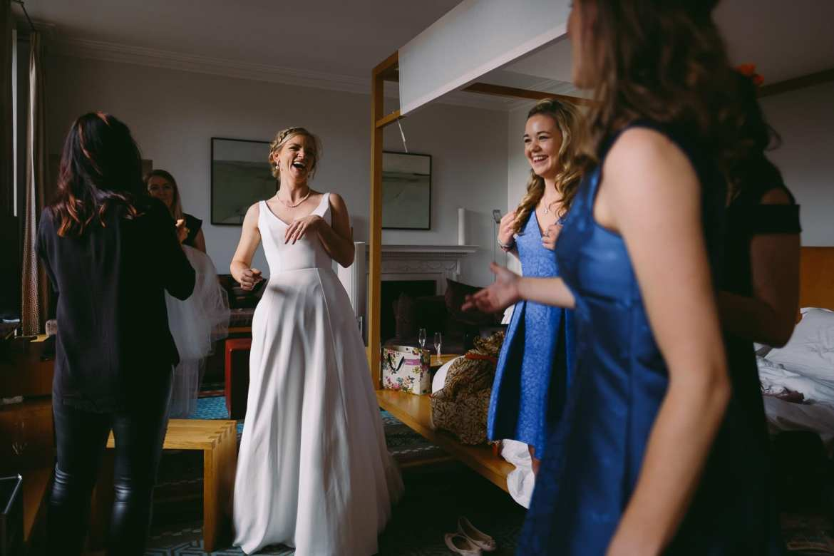 Girls all having a laugh during the bridal prep