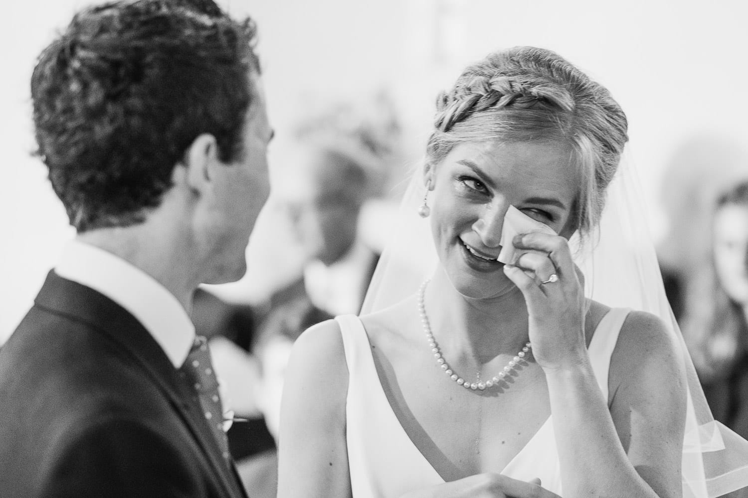 The bride wipes away a tear