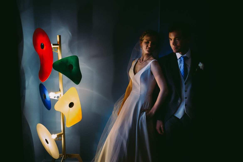 Indoor portrait of bride and groom in Cowley Manor