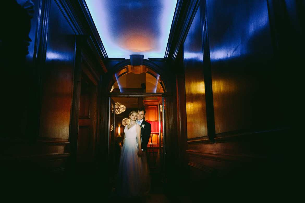 Portrait of bride and groom waiting to go into wedding breakfast at Cowley Manor