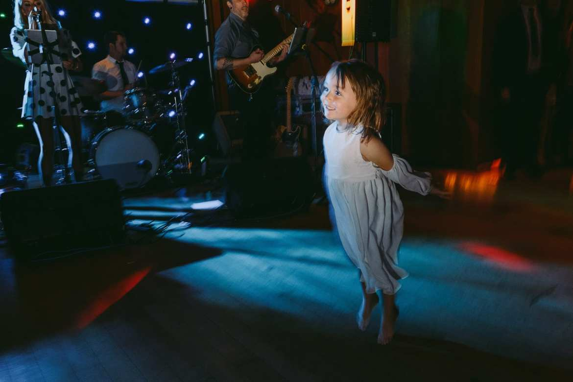 Flower girl on the dance floor at Cowley Manor