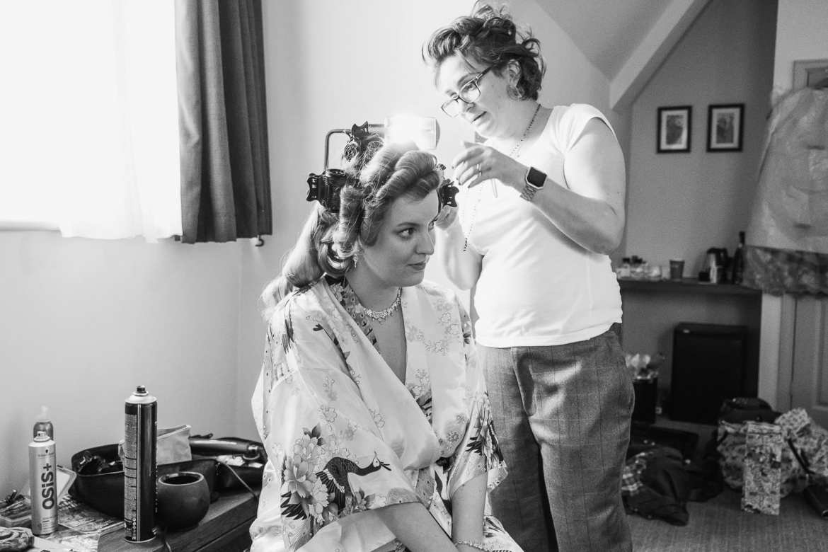 The bride has her hair done