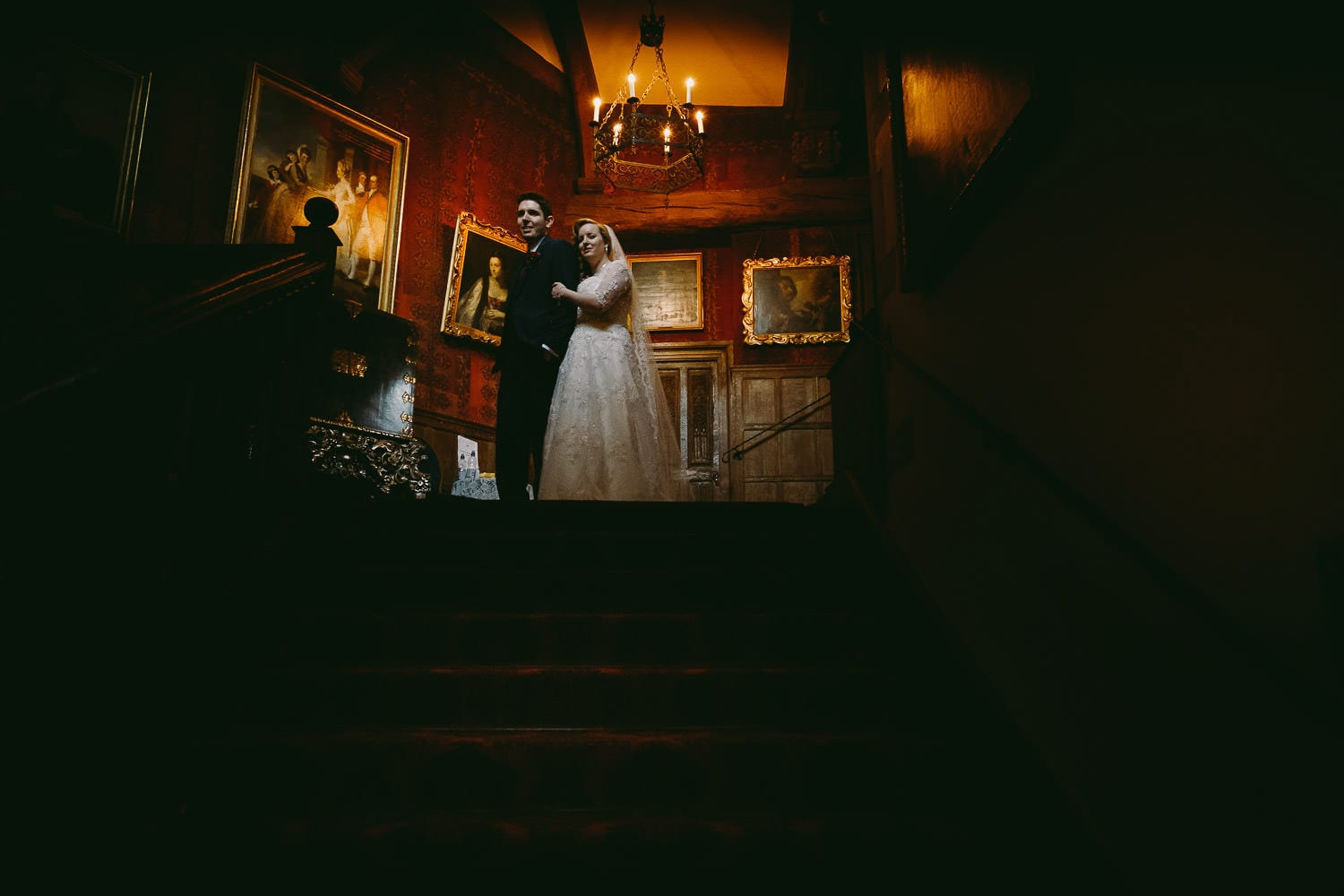 The bride and groom at the top of the stairs