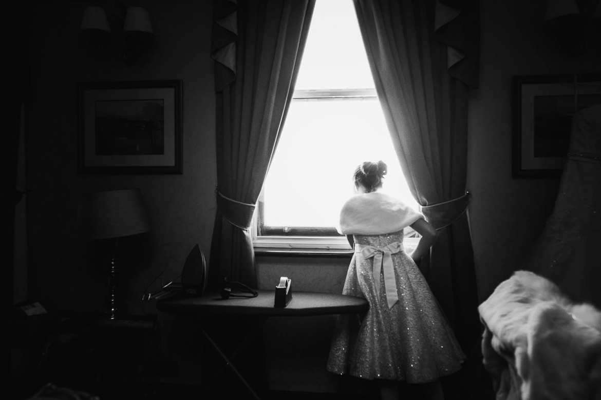 The flower girl looking out the window