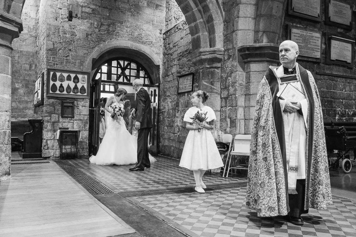 As the bride walks into the church her veil gets snagged