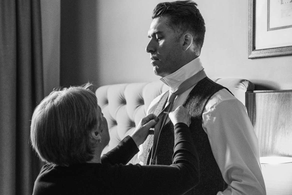 The mother of the groom does his tie