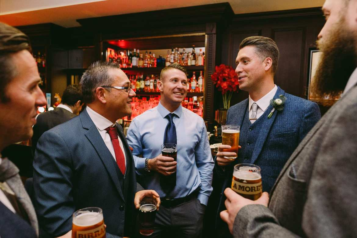 The groom chats with his mates