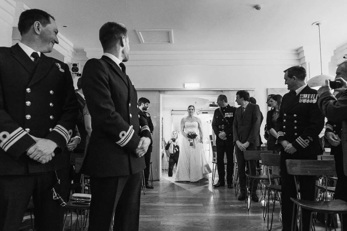 The bride walks up the aisle