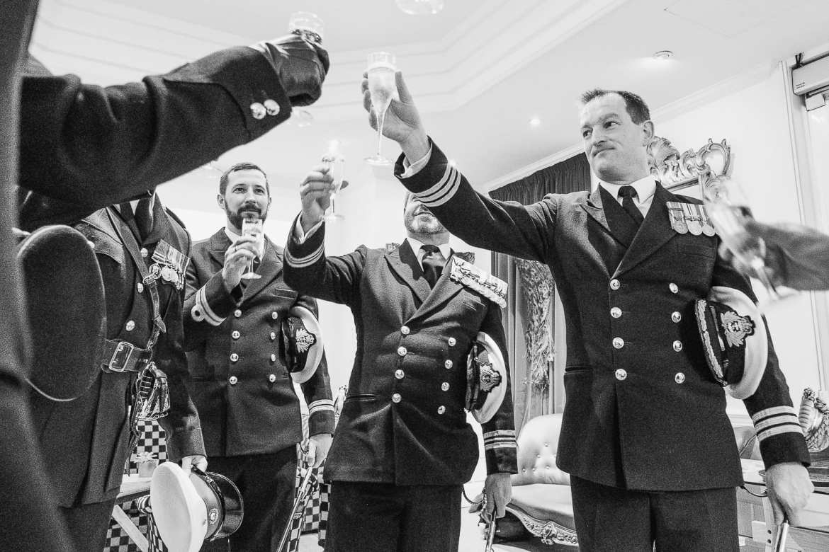 The military guard of honour toast their success