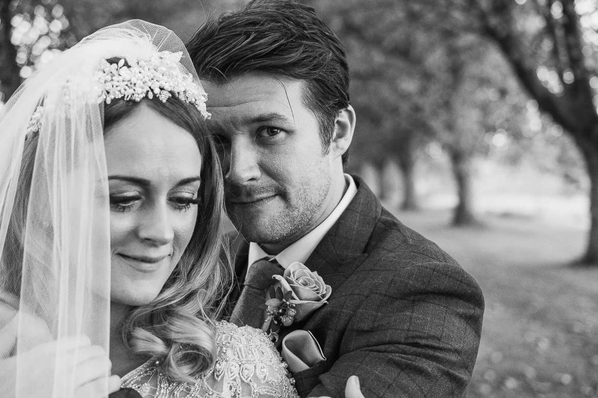 A black and white portrait of the bride and groom at Brympton House