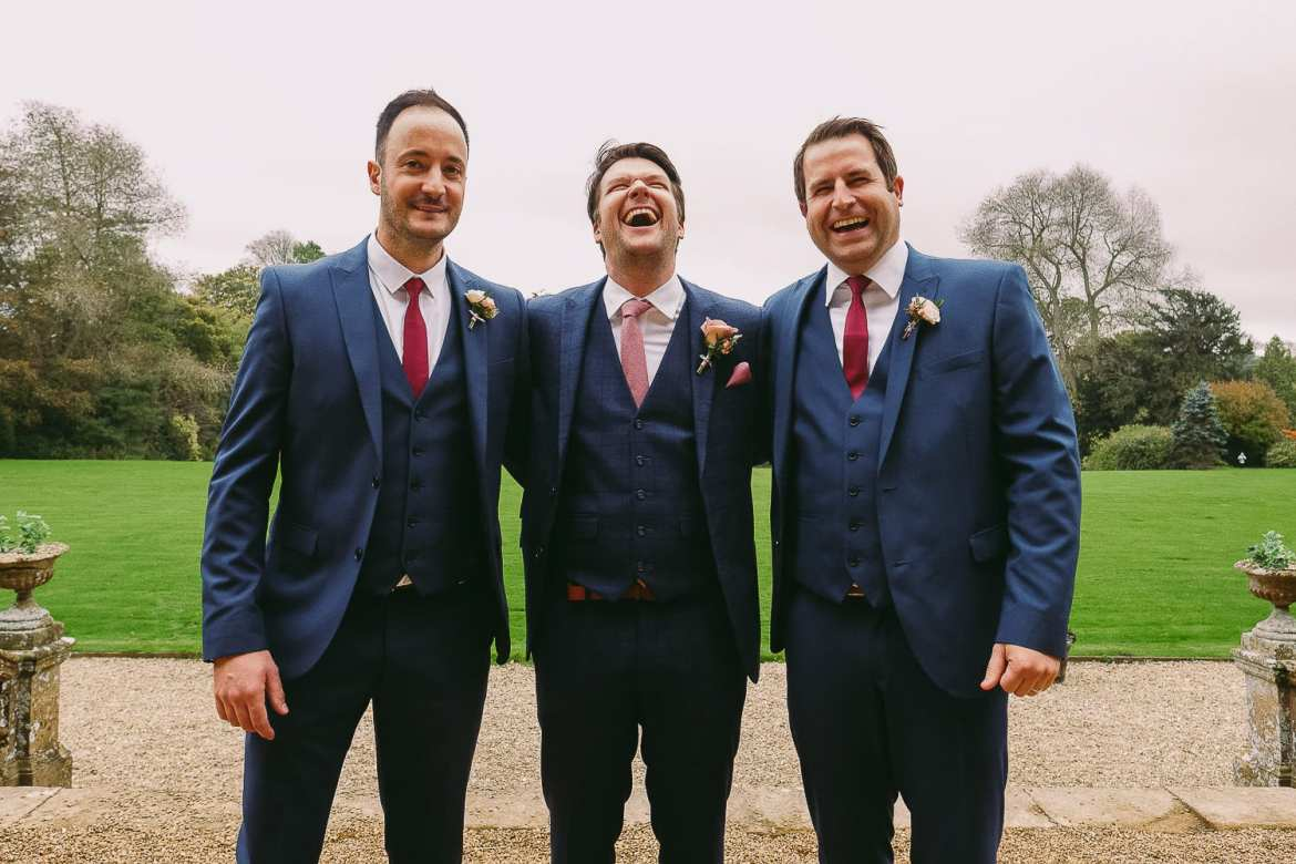 The groom and the two best men laughing