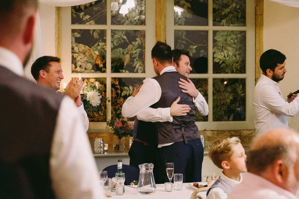One of the best men hugs the groom