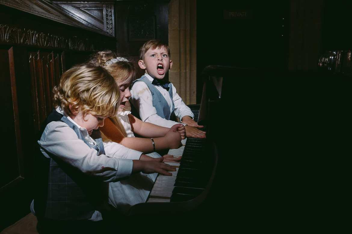 Three children play the piano