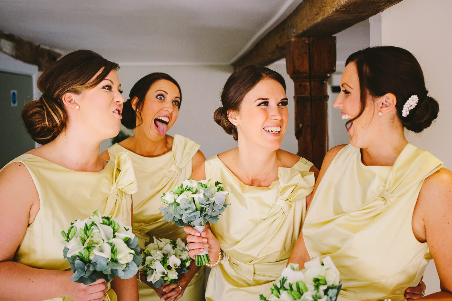 Bridesmaids pulling faces and laughing