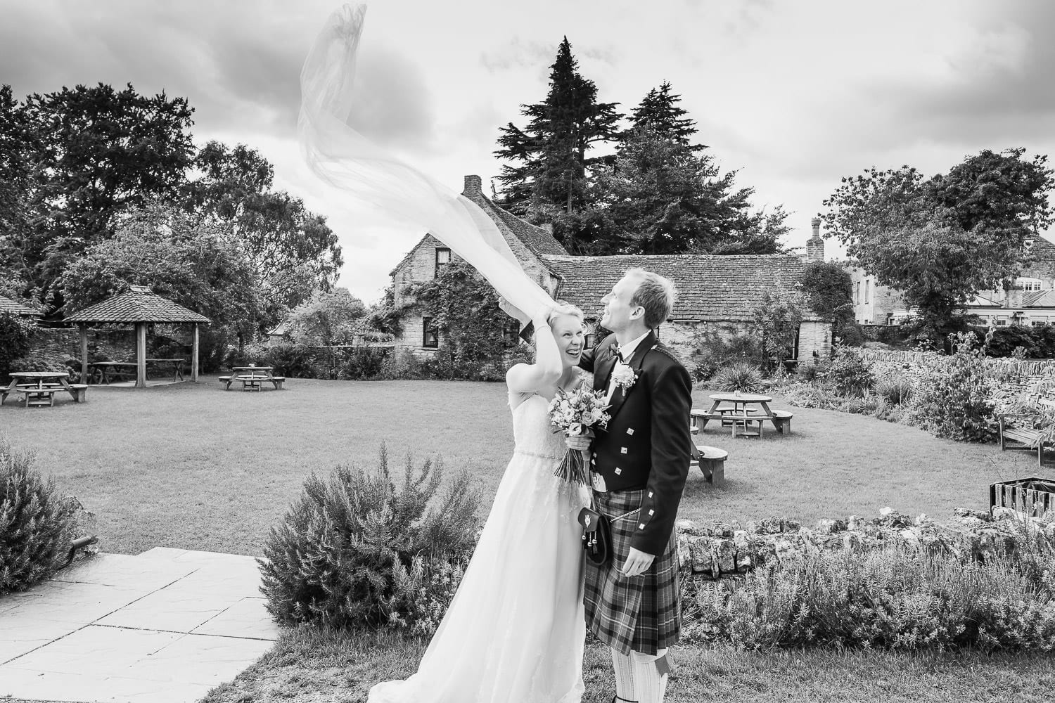 The bride's veil is swept up by the wind