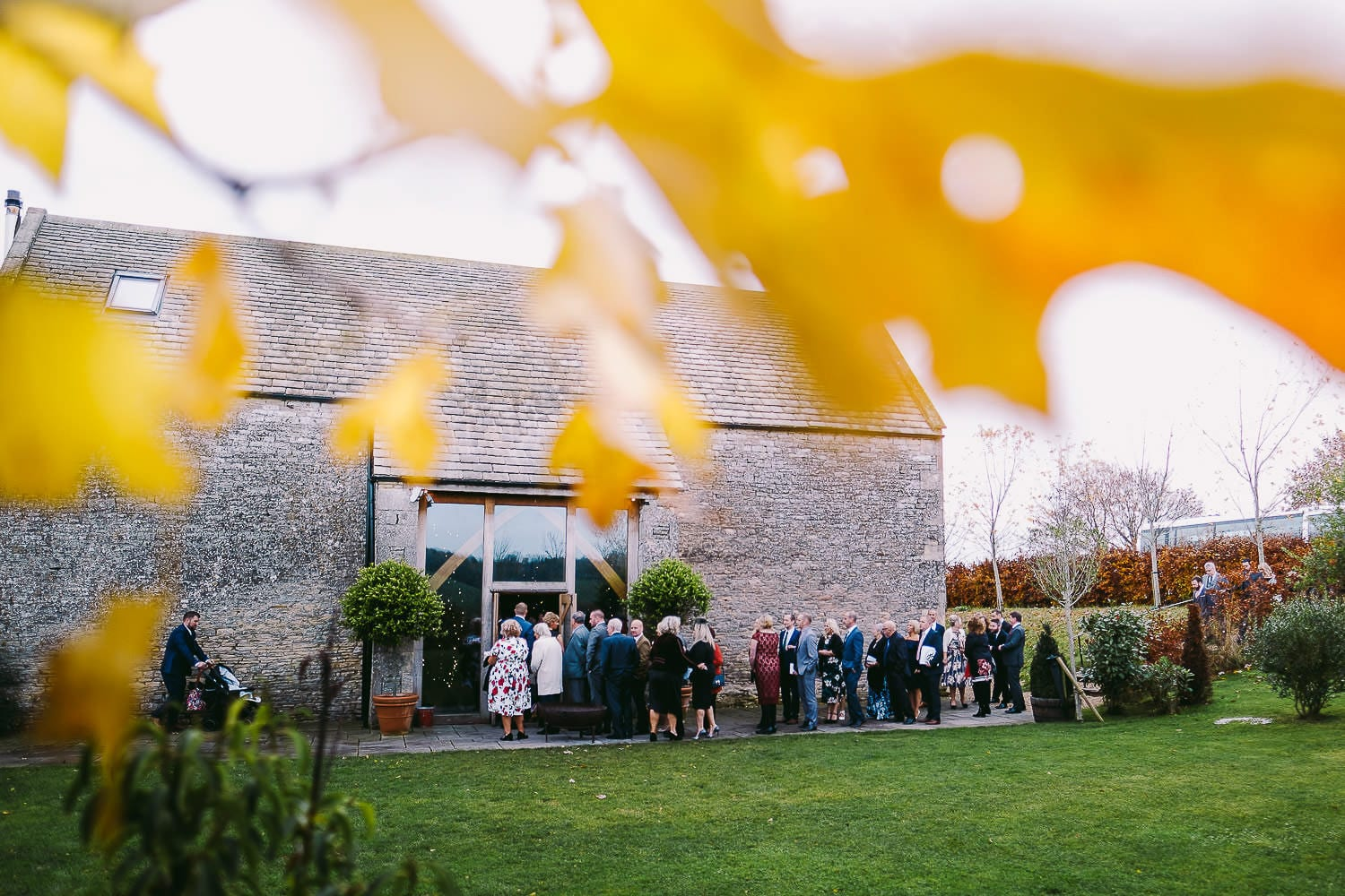 Wedding guests queueing outside Stone Barn