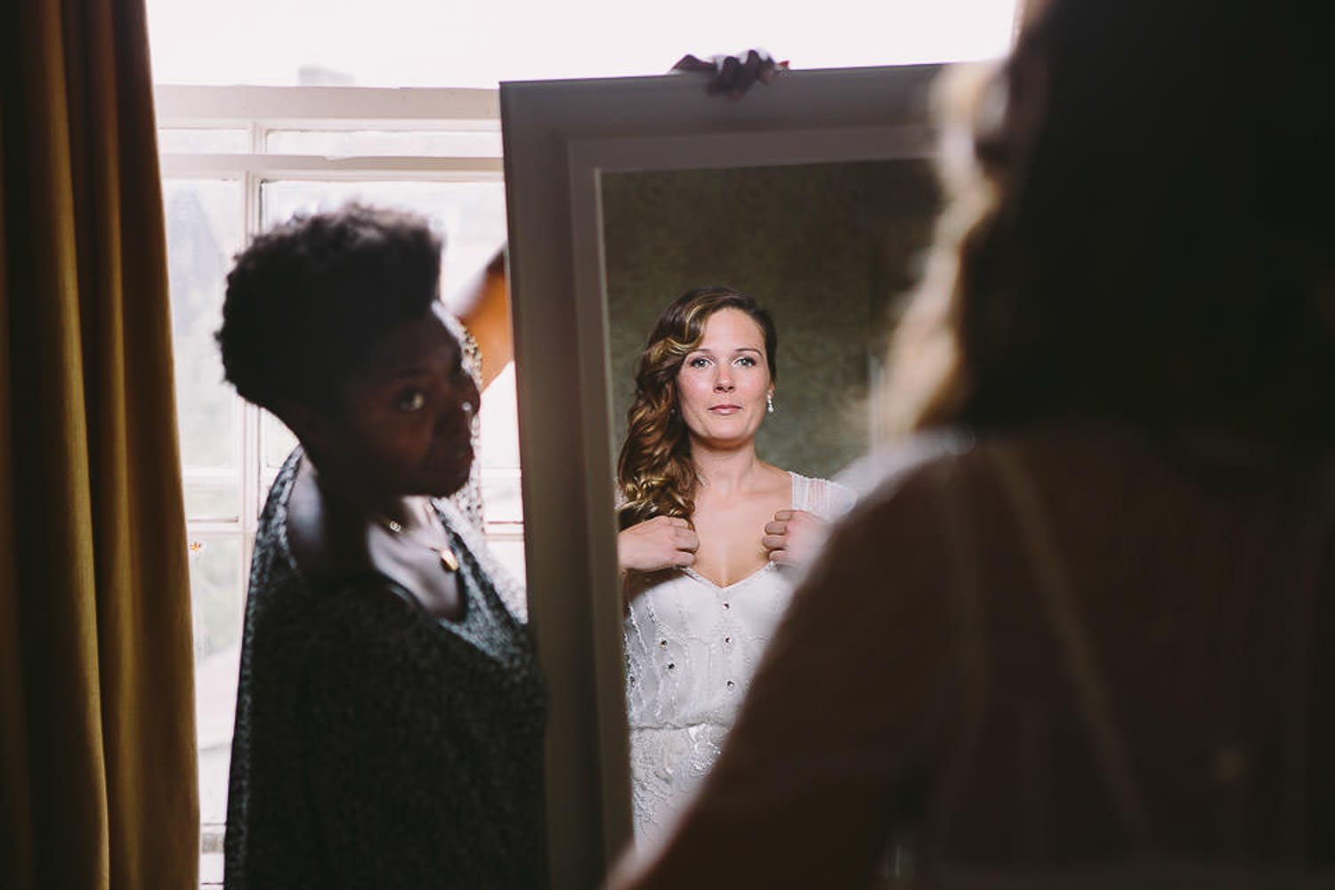 The bride sees herself in the mirror