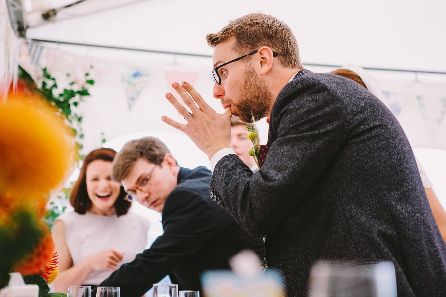 The groom eating cakes