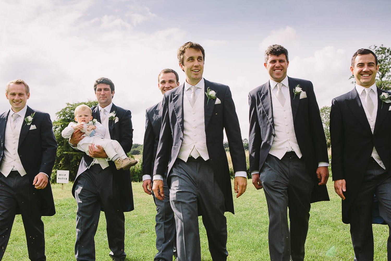 The groom and ushers walking