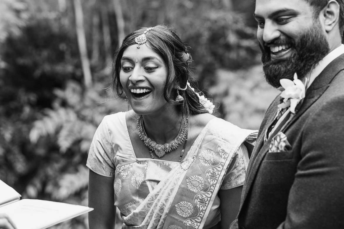 The bride and groom laughing during the wedding ceremony