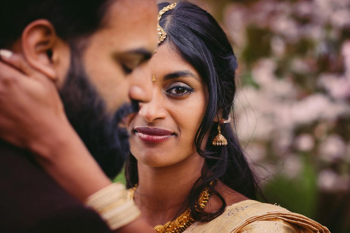 A portrait of the bride and groom in the gardens at The Matara Centre