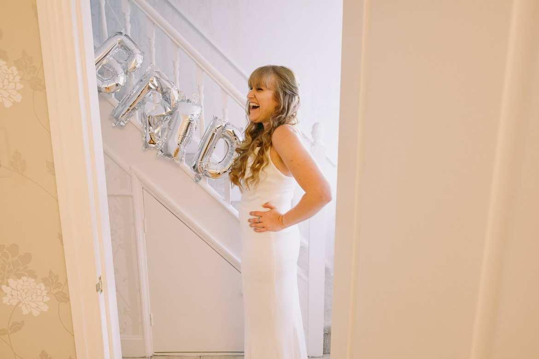 A bridesmaid laughing