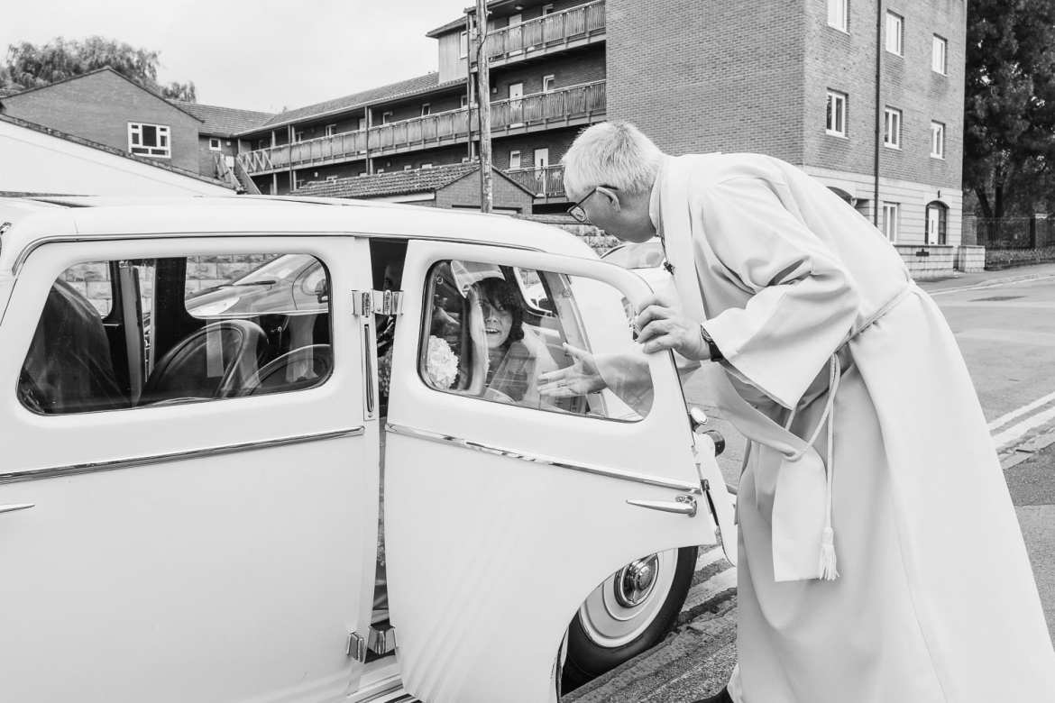 the vicar welcomes the bride