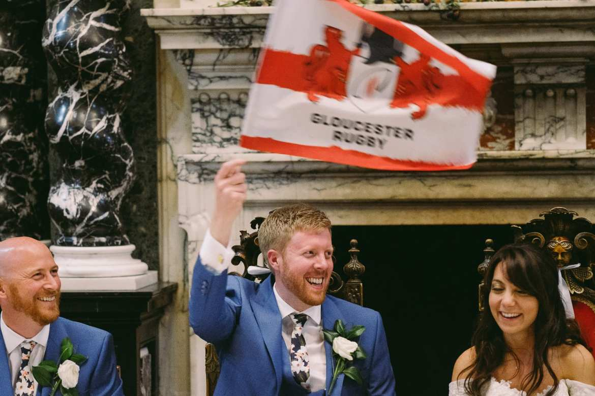 the bridegroom waves a Gloucester rugby flag