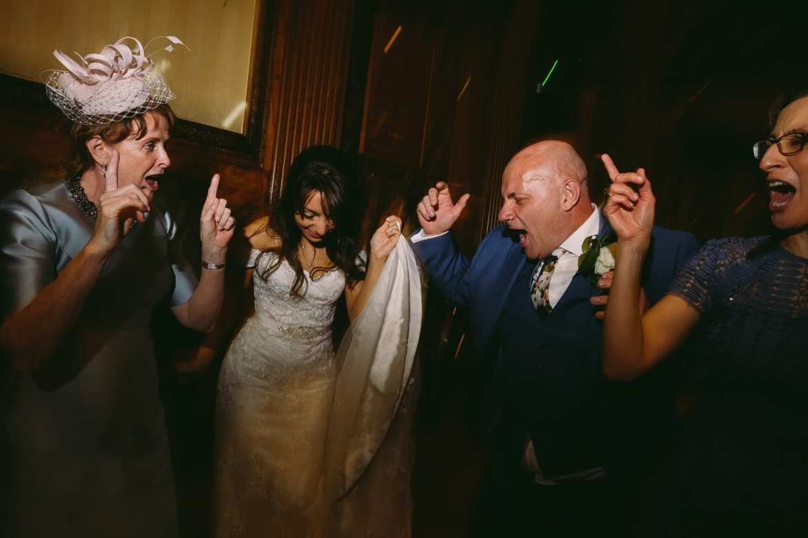 the bride dances with the parents