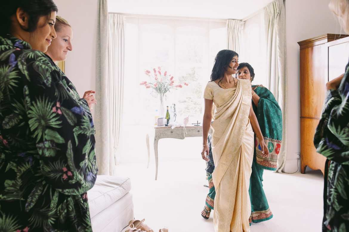 the indian bride puts on her sari