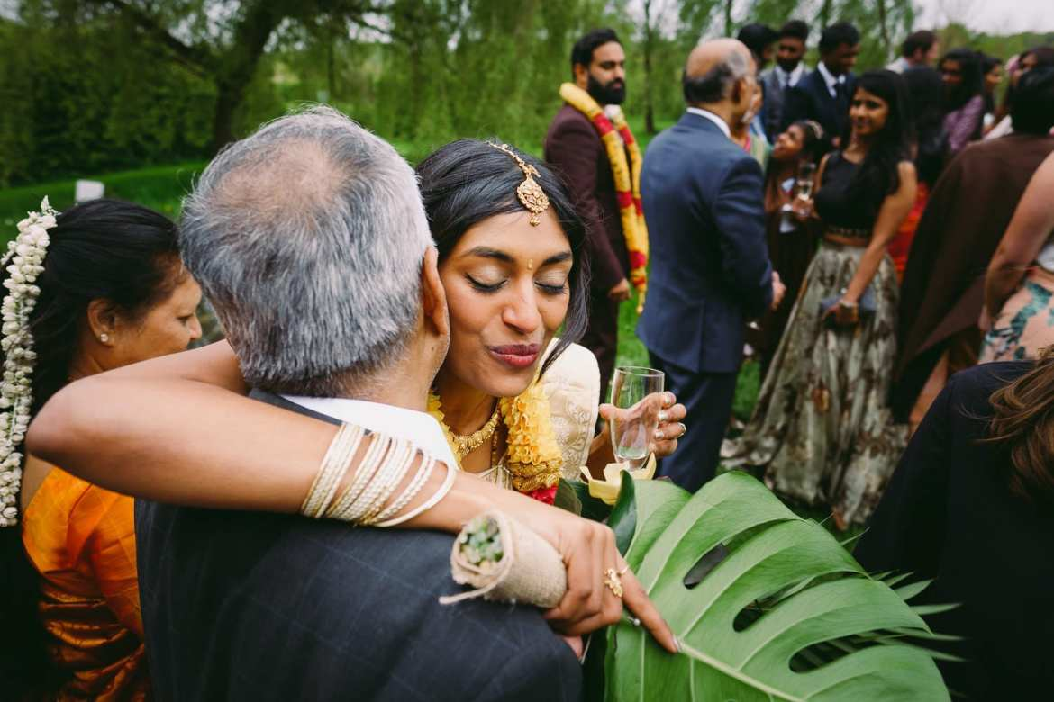 the bride hugs her father